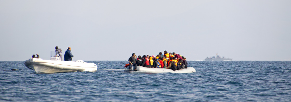 Migrant boat being towed