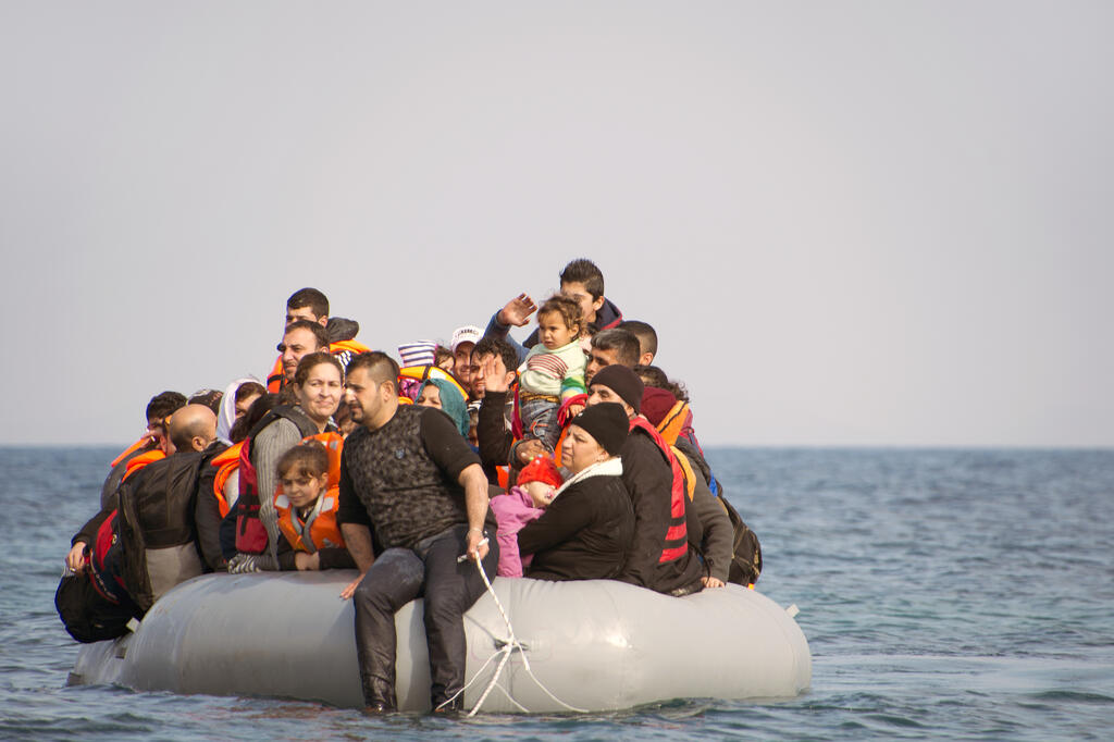 Migrant refugees in boat