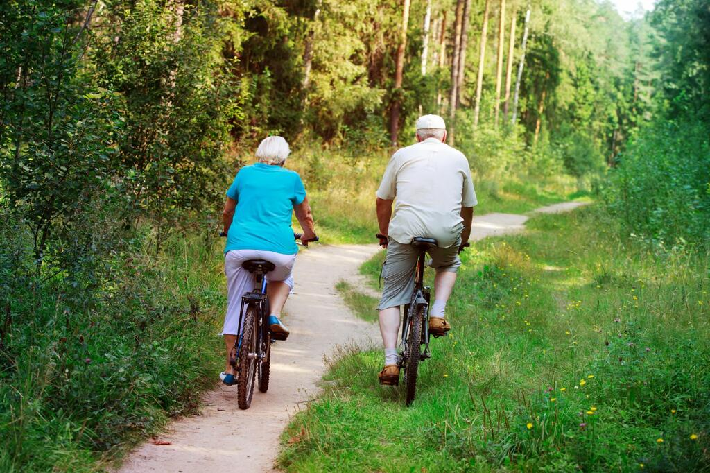 Old couple riding bikes