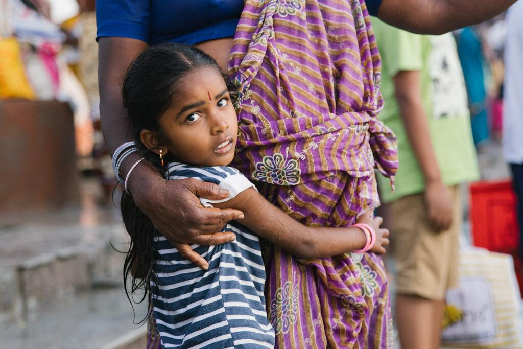 Girl clutching mother