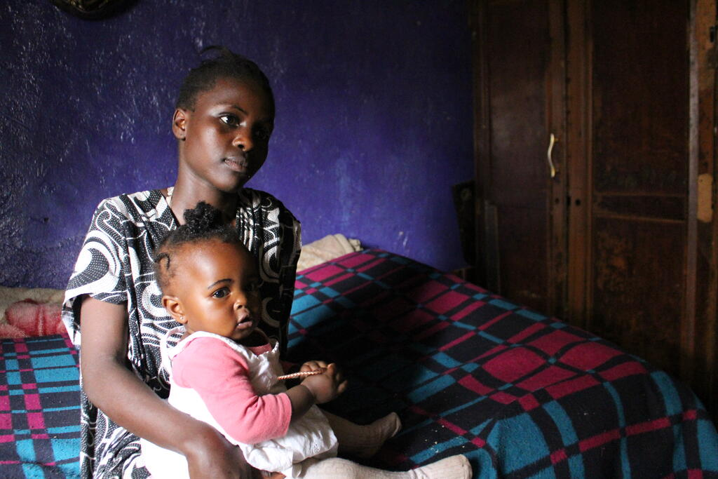 Kenyan woman with baby
